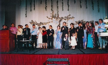 toasting on stage at wedding banquet